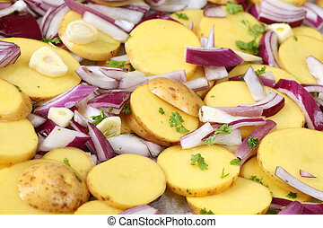 Raw potatoes with red onion, garlic and parsley