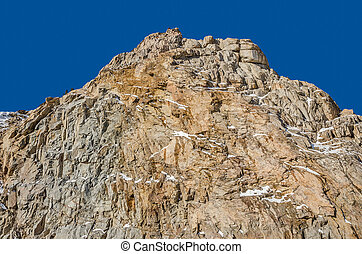 Mountainside - Mostly treeless mountain with a small amount...