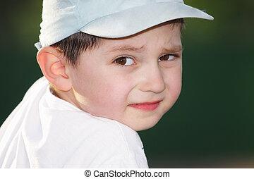 Boy looking over shoulder - Little boy looking over shoulder...