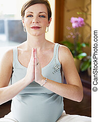 pregnant woman doing yoga at home - italian 6 months...