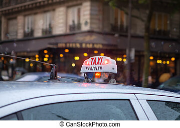 Taxi in Paris - Paris Taxi sing on the roof of a...