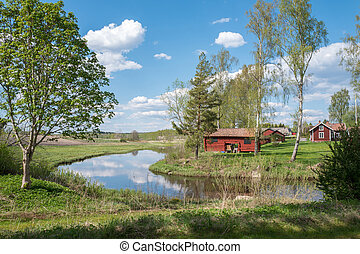 Spring in Sweden - Old traditional wooden buildings in...