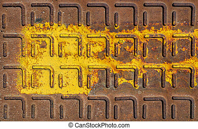 Manhole cover - Relief pattern of rusty manhole cover in...