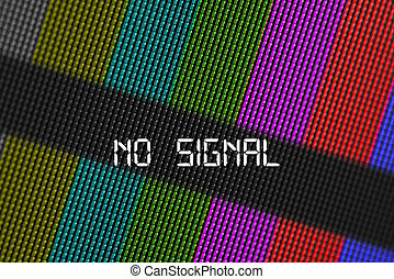 Closeup pixels of LCD TV screen with color bars and message no signal is a television test pattern