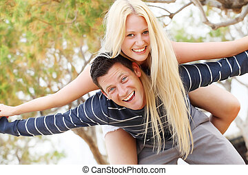 Young couple having fun Shallow DoF with focus on the man