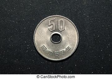 50 Japanese yen - 50 japanese yen coin on black color...