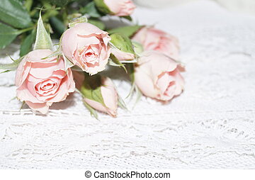 Bouquet of pink roses and white lace