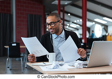 Handsome businessman looking at documents