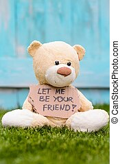 Teddy bear holding cardboard with information Let Me be Your...