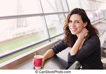 Portrait of beautiful 40 years old woman holding cup of...