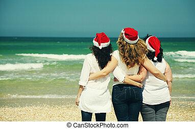 Three beautiful women wearing chris