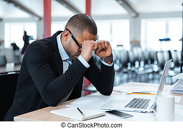Exhausted businessman at his desk - Overworked, depressed...