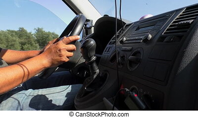 Minibus dashboard and driver hands - Side view of mini bus...