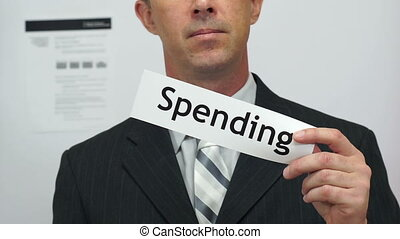 Businessman Cuts Spending Concept - Male office worker or...