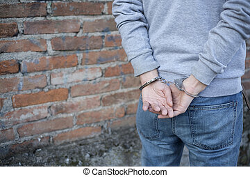 close up of handcuffed man hands