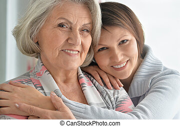 cheerful mother and adult daughter