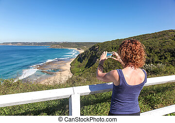 Tourist taking photo of Burwood Beach - Newcastle Australia...