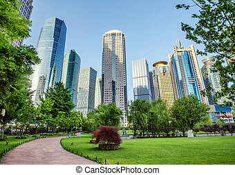 Parks and modern architecture - Park and modern building in...