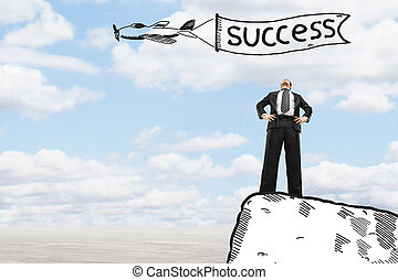 businessman standing on edge of cliff - businessman standing...
