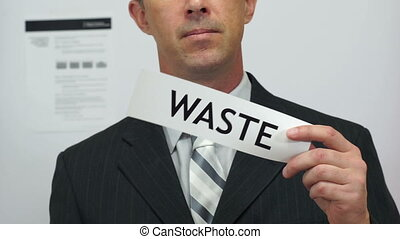 Businessman Cuts Waste Concept - Male office worker or...
