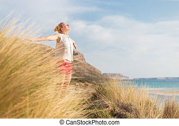 Free Happy Woman Enjoying Sun on Vacations. - Relaxed woman,...