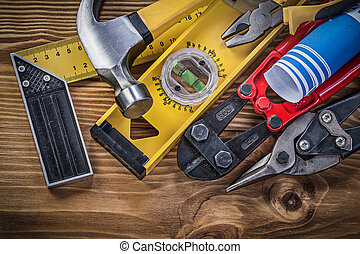Composition of construction tools on wooden board directly...