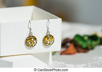 Earrings made of epoxy resin and glitters close up