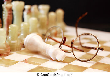 Chess Pieces And Spectacles - Set of chess pieces made from...