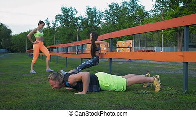 young health couple doing stretching exercise relaxing and...