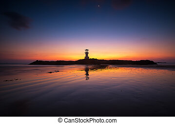 Light house with twilight sky, beach view in Thailand.