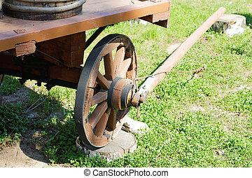 wooden cartwheel closeup summer day