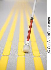 Blind pedestrian walking on tactile paving - Blind...