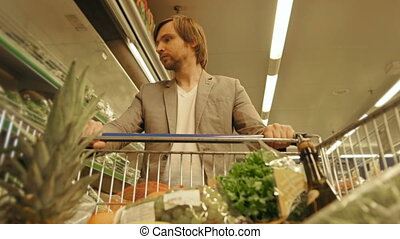 Handsome Man Shopping In A Supermarket, View From Shopping Trolley