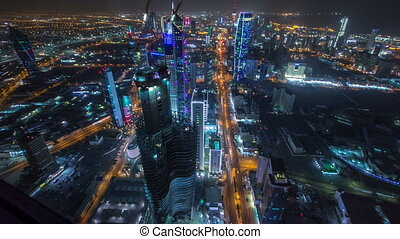 Skyline with Skyscrapers night timelapse in Kuwait City...