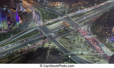 Skyline and traffic on crossroad night timelapse in Kuwait...