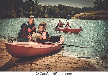 Group of people on kayaks reading map