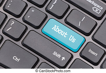 """Computer keyboard closeup with """"About Us"""" text on gblue enter key"""