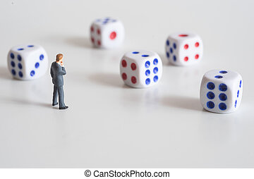 Businessman thinking with dice Business risk concept