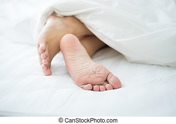 Feet in bed - Persons feet in bed