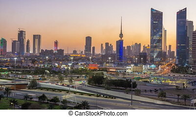 Skyline with Skyscrapers day to night timelapse in Kuwait...