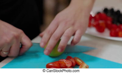 Cutting lime for a serving fish Cooking in Kitchen - Cutting...