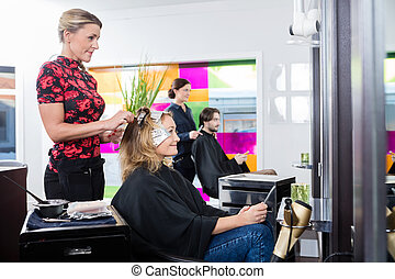 Woman Getting Her Hair Dyed In Salon - Mature woman getting...