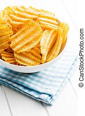 Crinkle cut potato chips - Crinkle cut potato chips on...