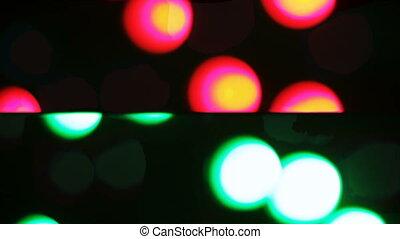 Running lights bokehs - Lanterns on kiddie rides shine on...