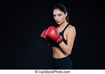 Fitness woman standing in boxing gloves