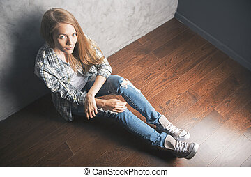 Topview girl sitting on floor - Top view of beautiful white...