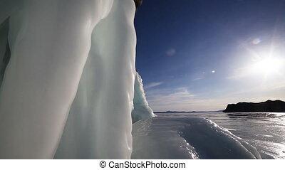 Sunset on freeze ice of the Baikal lake Slow camera motion...