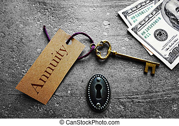 Annuity key - Gold key with Annuity tag, with keyhole and...