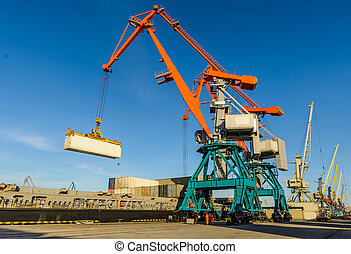 Port cranes and transport ship - Crane and unloading...