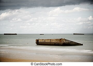 Arromanches - Ruins of harbor built by the Allies in...